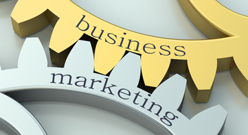 Interlocked gears displaying coupling of businesss and marketing