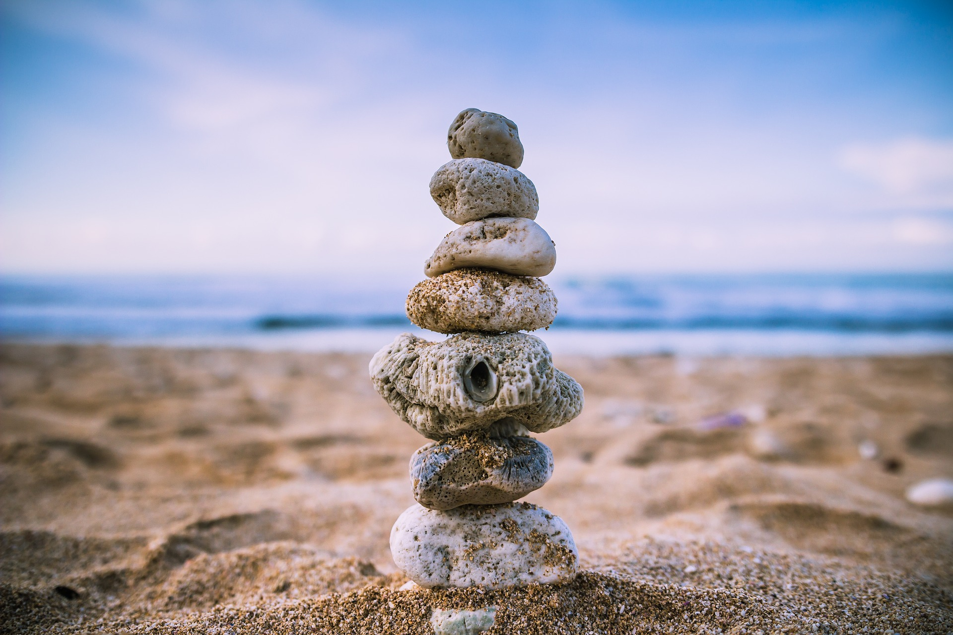rocks balanced over each other in a vertical column